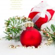 Stock Photo: Christmas balls and fir branches with decorations isolated over