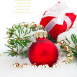 Christmas balls and fir branches with decorations isolated over — Stock Photo