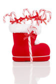 Santa's boot with candy canes on white background — Foto Stock