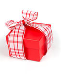Single red gift box with ribbon, on white background. — Stock Photo