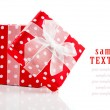 Red gift box with bow on white background — Stock Photo