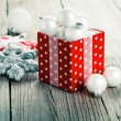 Red gift box, polka dots with, on wood background — Stock Photo #35508553