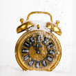 Antique gold clock in the snow. with copy space on a white backg — Stock Photo