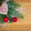 Christmas bauble with heart, on wooden background — Stok fotoğraf