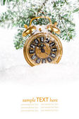 Vintage christmas decoration - antique golden clock and fir-tree — Stock Photo