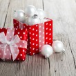 Red gift box, polka dots with, on wood background — Stock Photo #35510295