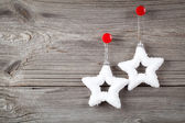 White christmas stars and sample text on wooden background — Stock Photo