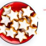 Christmas cinnamon star cookies on red plate — Stock Photo #36074731