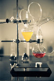 Glass laboratory apparatus with liquid samples — Foto Stock