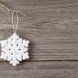 White christmas snowflake on wooden background — Stock Photo