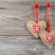Stock Photo: Hearts with red bow, on wooden background