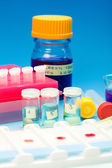 Array of blood samples for microscopy and biopsy tissue on blue — Stock Photo