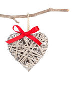 Heart shaped decoration made of wood, over white background — Stock Photo