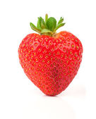 A heart shaped strawberry isolated on a white background — Stock Photo