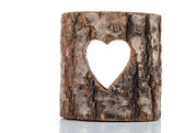Heart cut in hollow tree trunk. on white background — Stock Photo