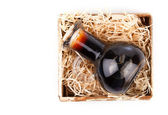 Bottles of wine or herbal syrup, in wooden box, over white backg — Stock Photo