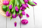 Spring tulips and Easter eggs on wooden background — Stok fotoğraf