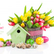 Easter eggs with tulips flowers and birdhouse, on a white backgr — Stock Photo