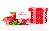 Beautiful tulips with red polka-dot gift box. happy mothers day, — Fotografia Stock