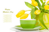 Yellow tulips flowers with cup tea, on a white background. break — Stock Photo