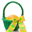 Easter egg in a basket on white background — Stock Photo