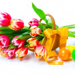 Red tulips flowers with Easter eggs, on a white background. — Stock Photo