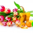 Stock Photo: Red tulips flowers with Easter eggs, on a white background.