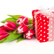 Beautiful tulips with red polka-dot gift box. happy mothers day, — Stock Photo #41037385