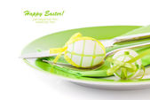 Easter eggs in a plate, on a white background — Stock Photo