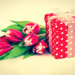 Beautiful tulips with red polka-dot gift box. happy mothers day, — Stock Photo #41394871