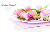 Pink tulips with quail eggs in a plate, on a white background. r — Stock Photo