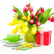 Постер, плакат: Tulips flowers with cup tea on a white background breakfast fo