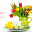 Easter eggs and blank for text in a plate, with tulips flowers o — Stock Photo #41856771