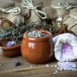 Stock Photo: Dry lavender flowers with bath salt, on wooden background