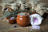 Dry lavender flowers with bath salt, on wooden background — Stock Photo