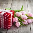 Beautiful tulips with red polka-dot gift box. happy mothers day, — Stock Photo #42721187