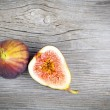 Fresh figs on a wooden background — Stock Photo #43749123