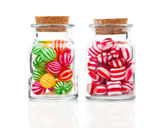 Two filled glass candy jars isolated over white background — Stock Photo