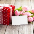 Beautiful tulips with red polka-dot gift box. happy mothers day, — Stock Photo #46593921