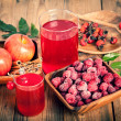 Raspberries and raspberry Cocktail in the wooden bowl — Stock Photo #46594897