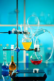 Glass laboratory apparatus with liquid samples — Stock Photo