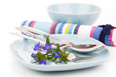 Tableware with blue lobelia flowers and cutlery, on a white back — Stock Photo