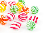 Colored candies isolated on white. — Stock Photo