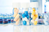 Colorful medical capsules in bottle, on white background — Stock Photo