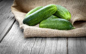 Cucumbers on the wooden background — Stock Photo