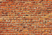 červená cihlová zeď na pozadí — Stock fotografie