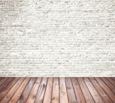 Interior room with white brick wall and wooden floor — Stock Photo