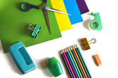 Color paper, scissors, pencils, sharpener, puncher — Stock Photo