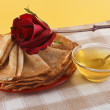 Royalty-Free Stock Photo: Pancakes, flower and honey on a napkin