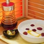 Porridge with raspberry in a plate — Stock Photo #23151592